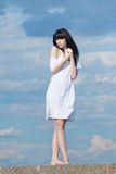 Brunette in white on open air Stock Photos