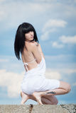 Brunette in white on open air Stock Images