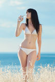 Brunette in white on open air Royalty Free Stock Photo