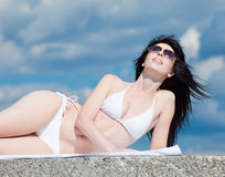 Brunette in white at the sea Royalty Free Stock Photos
