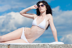 Brunette in white at the sea Royalty Free Stock Image