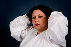 Brunette in a white shirt royalty free stock photos