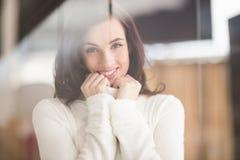 Brunette in white wool jumper posing Stock Photography