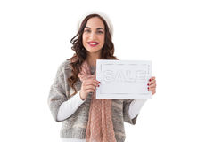 Brunette in winter clothes holding sale sign Stock Photography
