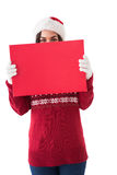 Brunette in winter clothes holding sign Stock Image