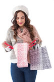 Brunette in winter clothes looking in shopping bag Royalty Free Stock Image