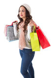 Brunette in winter clothes posing with shopping bags Stock Photo