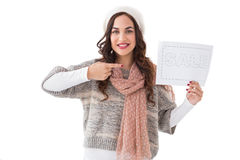 Brunette in winter clothes showing sale sign Stock Image