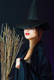 Brunette witch Stock Image