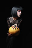 Brunette witch in night of Halloween Royalty Free Stock Images