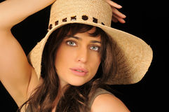 Brunette Woman. Portrait of beautiful brunette woman with hat Royalty Free Stock Image