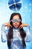 Brunette woman. With a disco ball over abstract background stock photo