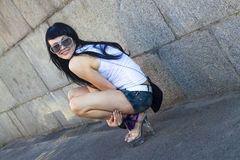 Brunette woman. Attractive brunette woman posing in sunglasses Stock Images