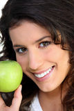 Brunette woman and an apple Stock Photography