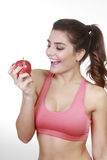 Brunette woman with apple Stock Photos