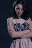 Brunette woman with arms folded Royalty Free Stock Images