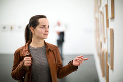 Brunette woman in art museum Stock Photo