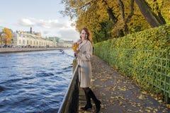 brunette woman in autumn beige coat Royalty Free Stock Image