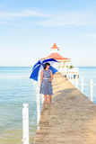 Brunette woman with a beach umbrella Royalty Free Stock Photos