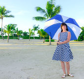 Brunette woman with a beach umbrella Royalty Free Stock Photo