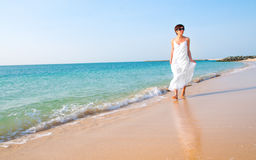 Brunette woman on beach Stock Photography