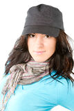 Brunette woman with a beautiful black hair in cap. Portrait of brunette woman with a beautiful black hair in cap isolated on white, more photos from this series royalty free stock photography