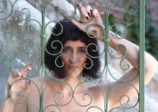 Brunette woman behind bars Royalty Free Stock Images
