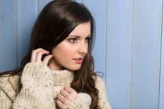Brunette woman in beige sweater looking aside Royalty Free Stock Photography