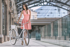 Brunette woman with bicycle Stock Photo