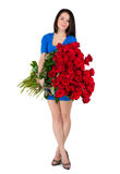 Brunette woman with a big bouquet of red roses Royalty Free Stock Images