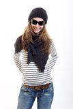 Brunette woman in black cap, sunglasses an shawl Stock Photos