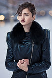 Brunette woman in black coat Stock Image