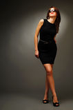 Brunette woman in black dress and glasses Royalty Free Stock Image