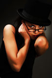 Brunette woman in black dress and glasses Royalty Free Stock Photos