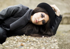 Brunette woman with black hat Stock Images