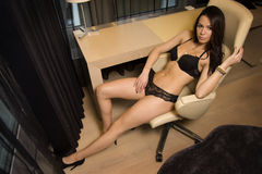 Brunette woman in black lingerie Royalty Free Stock Images