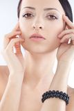 Brunette woman with black pearl bracelet on hand Stock Photography