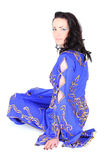 Brunette woman in blue arabian dress Stock Image