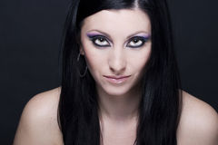 Brunette woman with blue and purple makeup Stock Photography