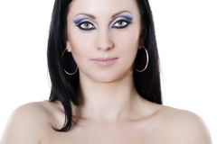 Brunette woman with blue and purple makeup Stock Photo
