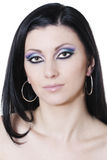 Brunette woman with blue and purple makeup Royalty Free Stock Image