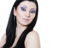 Brunette woman with blue and purple makeup Royalty Free Stock Photography