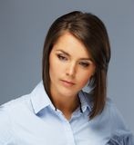 Brunette woman in blue shirt Royalty Free Stock Image