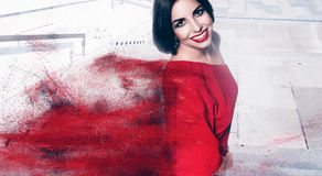 Brunette woman with bob cut and red powder Stock Photography
