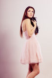 Brunette woman in bright dress with clutch bag Royalty Free Stock Images