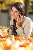 Brunette woman calling by phone. Young brunette woman calling by phone Royalty Free Stock Photos