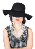 Brunette woman in chic pearl jewelry. Fashion hats Royalty Free Stock Photos