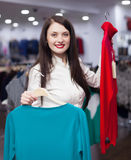 Brunette  woman choosing clothes at  store Stock Photo