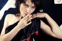 Brunette woman with a cigarette Stock Photo