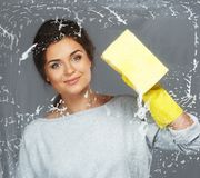 Brunette woman cleaning window glass Royalty Free Stock Photography